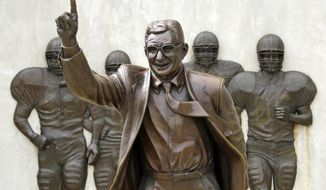 ** FILE ** The statue of former Penn State University head football coach Joe Paterno stands outside Beaver Stadium in State College, Pa., in this July 13, 2012, file photo. The statue was been taken down on Sunday, July 22, 2012. (AP Photo/Gene J. Puskar, File)