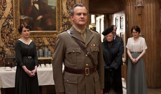 """From left, Elizabeth McGovern as Lady Cora, Hugh Bonneville as Lord Grantham, Maggie Smith as the Dowager Countess and Michelle Dockery as Lady Mary are shown in a scene from the second season of """"Downton Abbey,"""" which airs on PBS. (Associated Press)"""