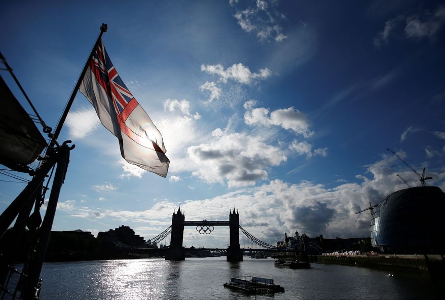 Tower Bridge over the Thames River displays the iconic Olympic rings to welcome athletes, spectators and visitors to the 2012 Summer Games. (Associated Press)