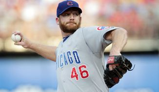 Trade talks indicate Ryan Dempster will be shipped from Chicago to Atlanta, but with 10 years in the majors and five with the Cubs, he has the right to veto the deal. (Associated Press)