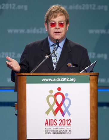 Sir Elton John speaks at the XIX International AIDS Conference, Monday, July 23, 2012, in Washington. (AP Photo/Carolyn Kaster)