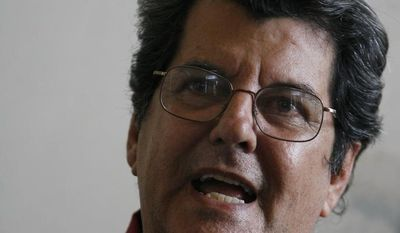 ** FILE ** In this Nov. 22, 2007, file photo, Cuban dissident Oswaldo Paya speaks during a news conference in Havana. Paya died in a car crash. He was 60 years old. (AP Photo/Javier Galeano, file)