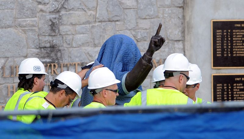 Penn State Office of Physical Plant workers cover the statue of former football coach Joe Paterno near Beaver Stadium on Penn State's campus in State College, Pa., on Sunday, July 22, 2012. (AP Photo/Centre Daily Times, Christopher Weddle)