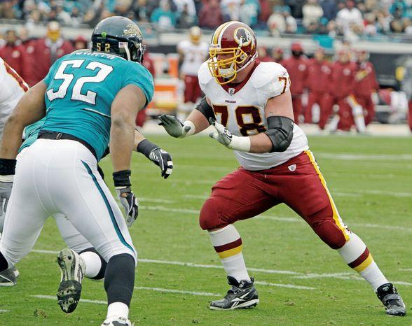 Washington Redskins guard Kory Lichtensteiger (78) blocks Jacksonville Jaguars linebacker Daryl Smith (52) during the first half of an NFL football game in Jacksonville, Fla., Sunday, Dec. 26, 2010.(AP Photo/John Raoux)
