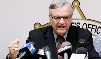 ** FILE ** Maricopa County, Ariz., Sheriff Joe Arpaio answers questions May 10 in a news conference. (Associated Press)