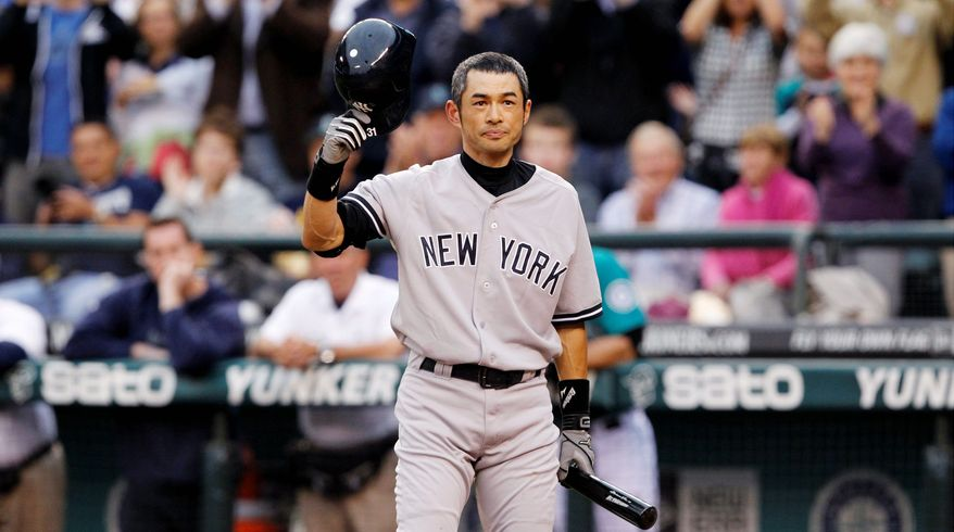 ASSOCIATED PRESS  Outfielder Ichiro Suzuki acknowledges cheers from Mariners fans Monday night during his first game as a New York Yankee after 11-plus seasons in Seattle.