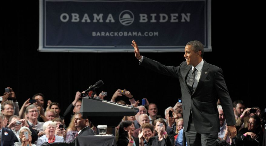 President Obama speaks at a fundraiser in Portland, Ore., on Tuesday. A new 30-second ad is aimed at damage control over remarks the president made July 13 in Roanoke, Va. (Associated Press)