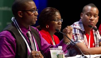 **FILE** Lawrence Stallworth II (left), 20, of Cleveland, who was diagnosed with HIV at 17, speaks July 22, 2012, on a youth panel at the International AIDS Conference in Washington. Sitting next to Stallworth is Helena Nangombe, of Namibia, and Romane Knight, of Jamaica. (Associated Press)