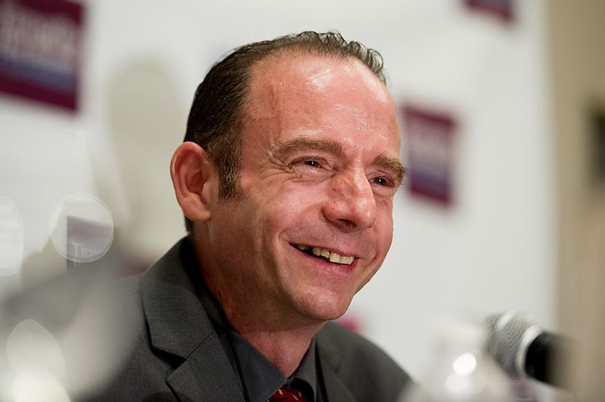 Timothy Ray Brown, the man believed to be the only known patient completely cured of the AIDS virus, speaks July 24, 2012, at a press conference at the Westin City Center in Washington, D.C., during the the biennial international AIDS conference. (Andrew Harnik/The Washington Times)
