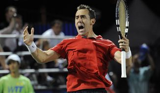 Washington Kastles' Bobby Reynolds reacts during a men's singles World TeamTennis match against New York Sportimes' Jesse Witten, Thursday, July 12, 2012, in Washington. (AP Photo/Nick Wass)