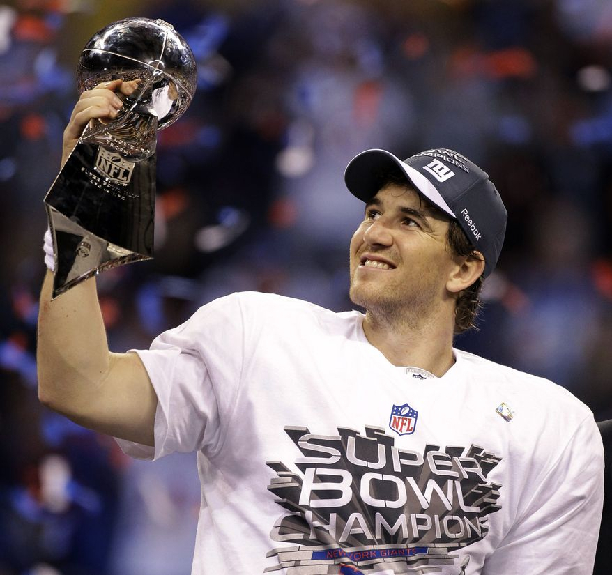 **FILE** New York Giants quarterback Eli Manning celebrates Feb. 5, 2012, with the Vince Lombardi Trophy after the Giants' 21-17 win over the New England Patriots in Super Bowl XLVI in Indianapolis. (Associated Press)