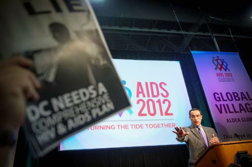 D.C. Mayor Vincent C. Gray tries to offer his remarks to the crowd while being shouted down by activists seeking housing for people with HIV/AIDS as he tries to deliver his speech to the crowd at the XIX International AIDS Conference at the Walter E. Washington Convention Center in Washington, D.C., Monday, July 23, 2012. (Rod Lamkey Jr./The Washington Times)