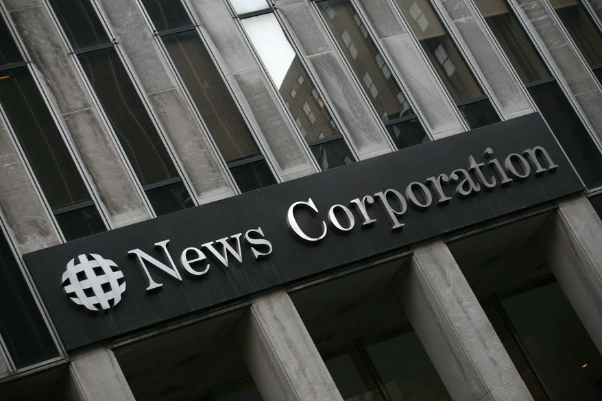 ** FILE ** This Monday, Feb. 1, 2010, file photo, shows News Corp.'s headquarters in New York. (AP Photo/Mark Lennihan, File)