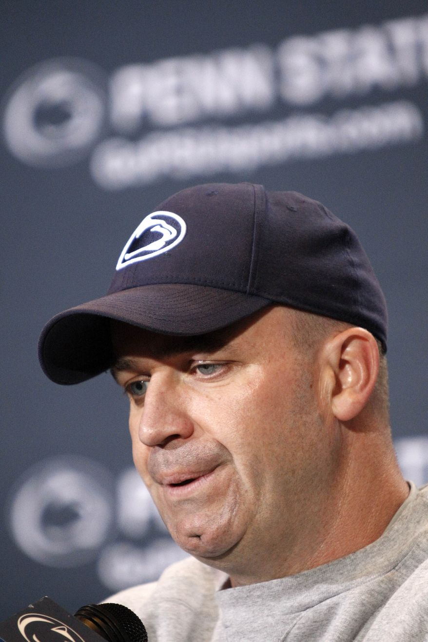 FILE - This April 21, 2012 file photo shows Penn State head coach Bill O'Brien during a news conference after the NCAA football team's annual Blue White spring scrimmage, in State College, Pa. O'Brien says his priority right now is to try to convince his current players from transferring. (AP Photo/Keith Srakocic, File)