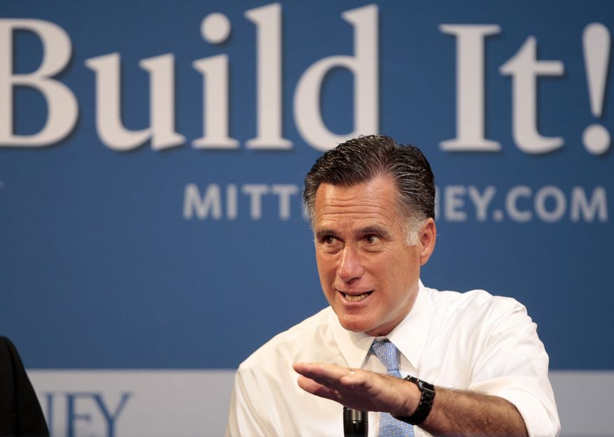 Republican presidential candidate Mitt Romney hosts a small-business roundtable July 23, 2012, during a campaign stop at Endural LLC in Costa Mesa, Calif. (Associated Press)