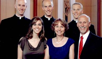 A family portrait shows (back from left) Vincent Strand, Luke Strand and Jacob Strand, and (front from left) Theresa Krausert, Bernadette Strand and Jerry Strand in Dousman, Wis., in 2009. The Strand brothers, ranging from 26 to 31, said they all felt their calling to serve the church independently, with no pressure from their parents, at a time when fewer men are going into the clergy. (Associated Press)