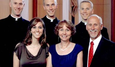 ASSOciated Press A family portrait shows (back from left) Vincent Strand, Luke Strand and Jacob Strand, and (front from left) Theresa Krausert, Bernadette Strand and Jerry Strand in Dousman, Wis., in 2009. The Strand brothers, ranging from 26 to 31, said they all felt their calling to serve the church independently, with no pressure from their parents, at a time when fewer men are going into the clergy.