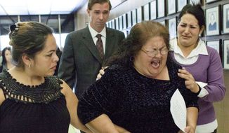 Genevieve Huizar (center), the mother of Manuel Diaz, who was fatally shot by Anaheim police, breaks down after a news conference in Santa Ana, Calif., on Wednesday. She asked for a stop to the violence and said she doesn't want that to be her son's legacy. Correna Chavez (left), her daughter, comforts her. (Associated Press)