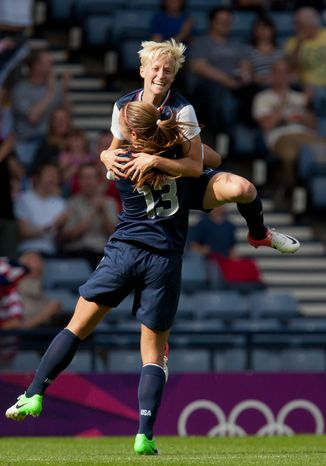 United States' Megan Rapinoe (right) leaps onto United States' Alex Morgan in celebration after Morgan scores a goal during the women's group G soccer match between the United States and France at the London 2012 Summer Olympics, Wednesday, July 25, 2012, at Hampden Park Stadium in Glasgow, Scotland. (AP Photo/Chris Clark)