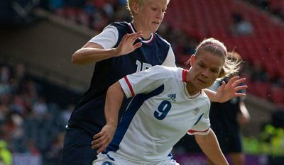 France's Eugenie Le Sommer (9) shields the ball from United States' Megan Rapinoe during the women's group G soccer match at the 2012 London Summer Olympics, Wednesday, July 25, 2012, at Hampden Park Stadium in Glasgow, Scotland. (AP Photo/Chris Clark)