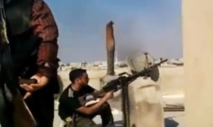 In this image made from amateur video, a Free Syrian Army solider fires his weapon during clashes with Syrian government troops in Aleppo, Syria. Turkey sealed its border with Syria to trucks on July 25, 2012, cutting off a vital supply line to the embattled nation as fighting stretched into its fifth day. (Associated Press/Ugarit News via AP video)