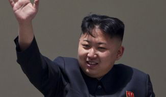 **FILE** North Korean leader Kim Jong Un waves April 15, 2012, from a balcony at the end of a mass military parade in Pyongyang's Kim Il Sung Square. (Associated Press)