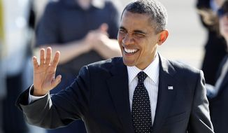 **FILE** President Obama waves July 24, 2012, to supporters on his arrival at Boeing Field in Seattle. (Associated Press)