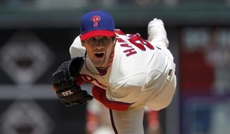 **FILE** Philadelphia Phillies pitcher Cole Hamels throws April 9, 2012, during the Phillies' home opener against the Miami Marlins. (Associated Press)