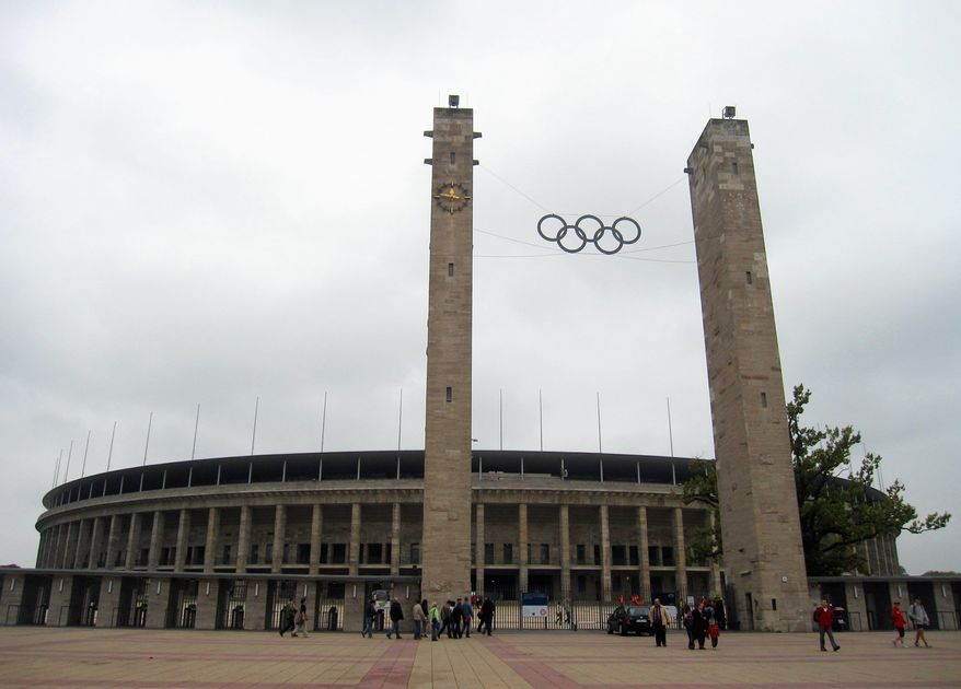 This Sept. 25, 2010 photo shows the Olympic rings on the approach to Olympiastadion Berlin, where U.S. gold medalist Jesse Owens won four gold medals during the 1936 Summer Olympics in Berlin. Germany hosted two notorious games: The 1936 Berlin Olympics, which Adolf Hitler tried to turn into a showcase of Aryan supremacy, and the 1972 Munich Olympics, married by a hostage crisis that left 11 Israelis dead. (Associeted Press)