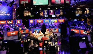 Players compete during the seventh day of the main event at the 43rd annual World Series of Poker July 16 at the Rio Hotel & Casino in Las Vegas. (Associated Press)