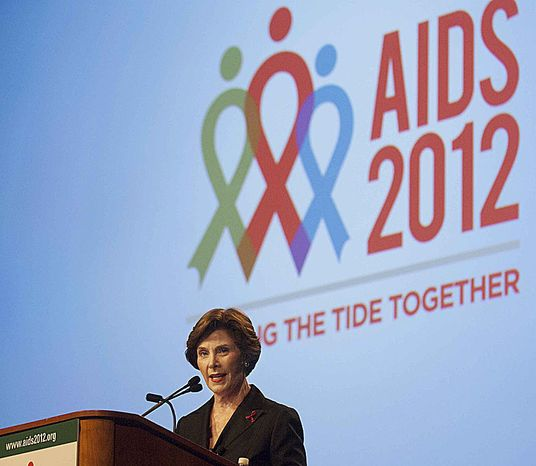 """Former first lady Laura Bush addresses the """"Leadership in the AIDS Response for Women"""" special session during the International AIDS Conference at the Washington Convention Center on Thursday, July 26, 2012, in Washington, D.C. The panel stressed that AIDS cannot be defeated without the empowerment of women at every level,  local, national, and international. (Raymond Thompson/The Washington Times)"""