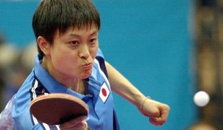 Japan's Chire Koyama returns a shot in her women's singles quarterfinals table tennis match Friday, Sept. 22, 2000 in Sydney. Koyama beat China's Wang Nan 21-19. 21-8, 22-20. (AP Photo/Elaine Thompson)