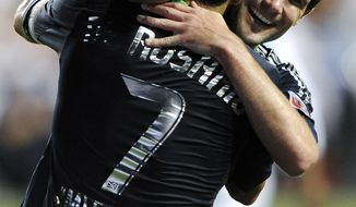 D.C. United All-Stars Chris Pontius (right) and Dwayne De Rosario celebrate after scoring against Chelsea in the MLS All-Star game in Chester, Pa., on Wednesday night. Pontius was named MVP in the MLS All-Stars' 3-2 win. (AP Photo/Michael Perez)