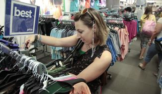 "** FILE ** In this June 8, 2012, photo, Michele Crosta, a freelance fashion and wardrobe stylist, shops at J.C. Penney in New York. Six months after J.C. Penney got rid of the hundreds of sales it offers each year in favor of a three-tier pricing approach, the mid-priced department store chain is revamping its pricing strategy again. Among other changes, the blue ""best price"" signs will be eliminated, and ""clearance"" signs will be reintroduced. (AP Photo/Bebeto Matthews)"