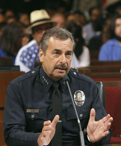 Los Angeles Police Chief Charlie Beck speaks a Los Angeles City Council meeting where the issue of whether to ban marijuana dispensaries that have sprung up throughout the city was being considered. (AP Photo/Nick Ut)