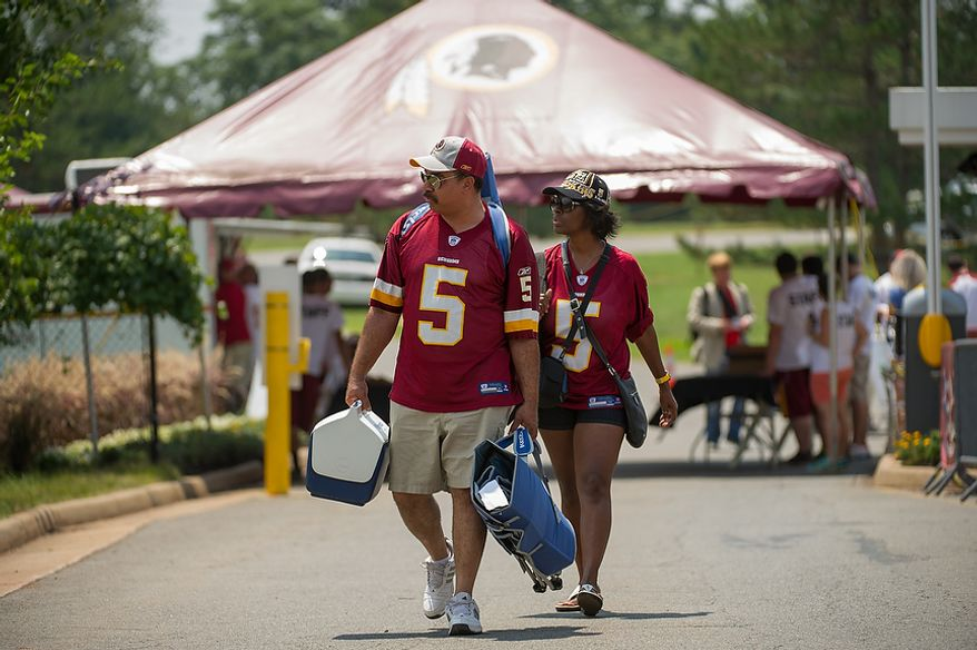 Washington Redskins fans Kenneth and Donna Cole of Ft. Washington, Md., arrive for the first day of training camp at Redskins Park, Ashburn, Va., Thursday, July 26, 2012. (Andrew Harnik/The Washington Times)