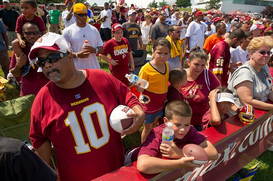 Washington Redskins fans watch afternoon practice on the first day of training camp at Redskins Park, Ashburn, Va., Thursday, July 26, 2012. (Andrew Harnik/The Washington Times)