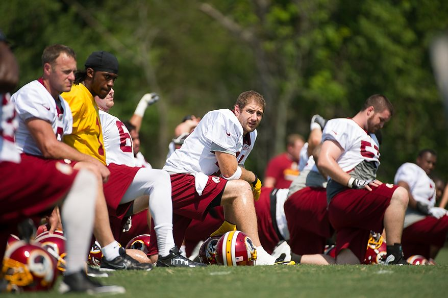 Washington Redskins tight end Chris Cooley (47), center, stretches during afternoon practice on the first day of training camp at Redskins Park, Ashburn, Va., Thursday, July 26, 2012. (Andrew Harnik/The Washington Times)