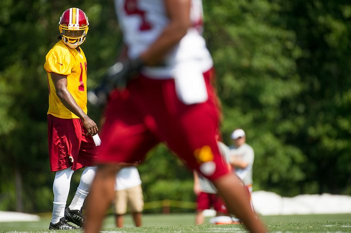 Washington Redskins quarterback Robert Griffin III (10) during afternoon practice on the first day of training camp at Redskins Park, Ashburn, Va., Thursday, July 26, 2012. (Andrew Harnik/The Washington Times)