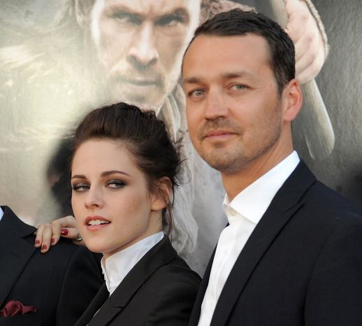 "** FILE ** This May 29, 2012, file photo shows actress Kristen Stewart and director Rupert Sanders attending the ""Snow White and the Huntsman"" screening in Los Angeles. (Photo by Jordan Strauss/Invision/AP)"
