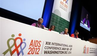 **FILE** Lawrence Stallworth II (left), 20, of Cleveland, who was diagnosed with HIV at age 17, speaks July 22, 2012, on a youth panel at the International AIDS Conference in Washington. Stallworth learned he was infected with HIV at age 17, when he was a high-school senior, after a hospitalization. A black gay man, he's among one of the nation's highest-risk groups. (Associated Press)