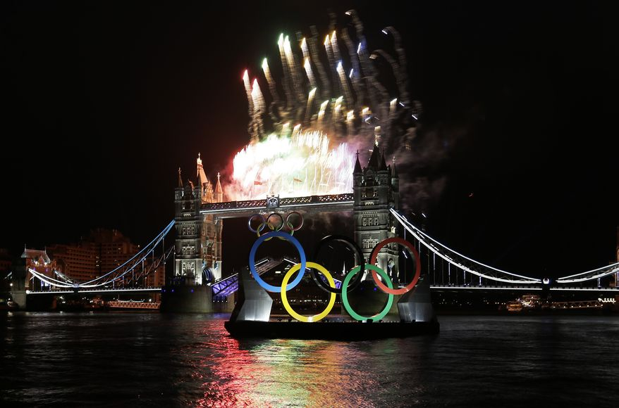 Fireworks and Olympic rings light up at Tower Bridge during the Opening Ceremony at the 2012 Summer Olympics, Friday, July 27, 2012, in London. (AP Photo/Kirsty Wigglesworth)