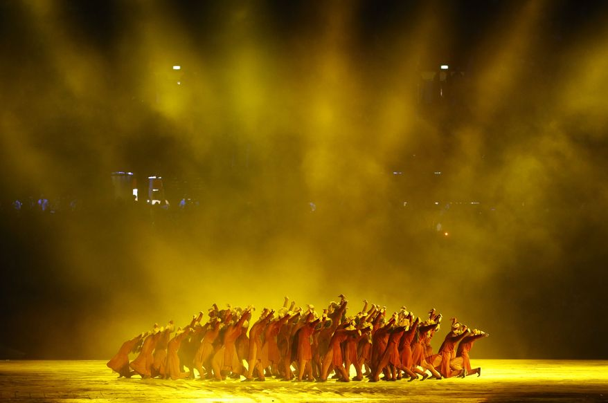 Performers dance during the Opening Ceremony at the 2012 Summer Olympics, Friday, July 27, 2012, in London. (AP Photo/Jae C. Hong)