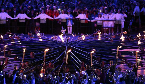 The Olympic cauldron is being lit during the Opening Ceremony at the 2012 Summer Olympics, Saturday, July 28, 2012, in London. (AP Photo/Ivan Sekretarev)