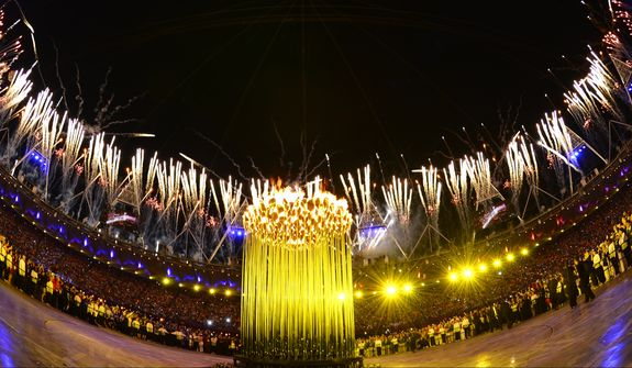 The closing ceremony of the 2012 Olympics will be streamed live online. Here are fireworks illuminating the sky after the Olympic cauldron was lit during the opening ceremony Saturday, July 28, 2012, in London.  (AP Photo/Leon Neal, Pool)