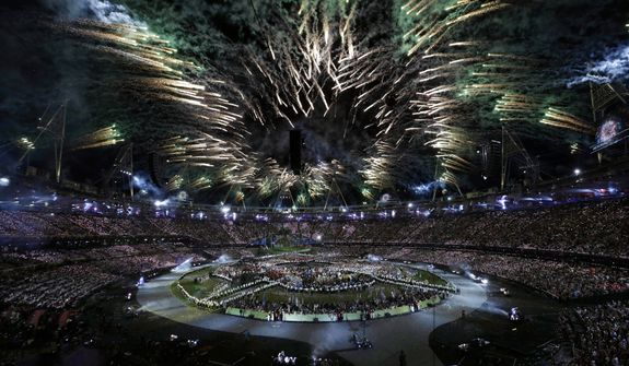 Lights illuminate the stadium during the Opening Ceremony at the 2012 Summer Olympics, Friday, July 27, 2012, in London. (AP Photo/Paul Sancya)