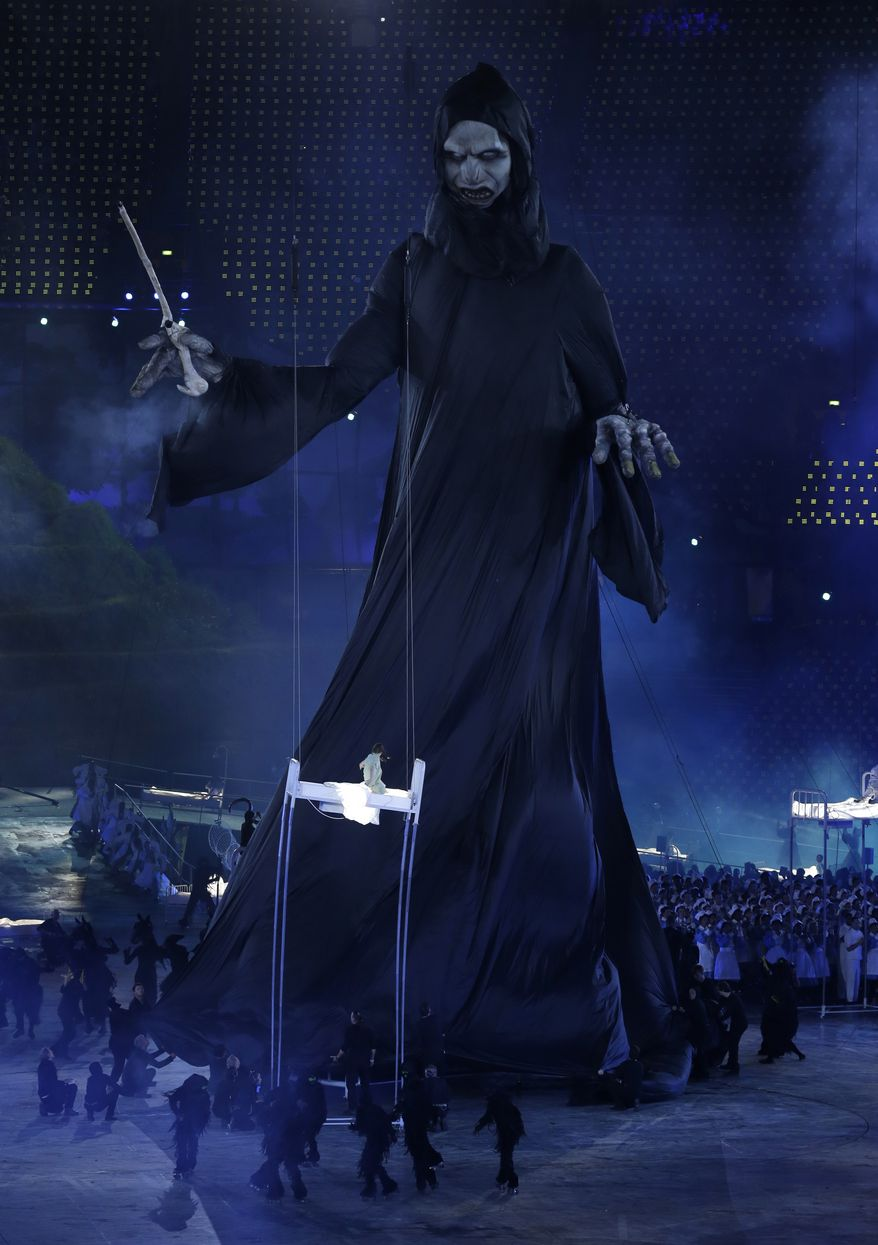 A giant figure stands out during the Opening Ceremony at the 2012 Summer Olympics, Friday, July 27, 2012, in London. (AP Photo/Paul Sancya)