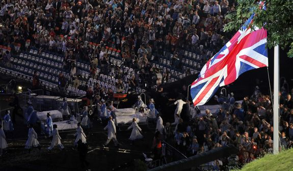 Performers march through the audience during the Opening Ceremony at the 2012 Summer Olympics, Friday, July 27, 2012, in London. (AP Photo/Christophe Ena)