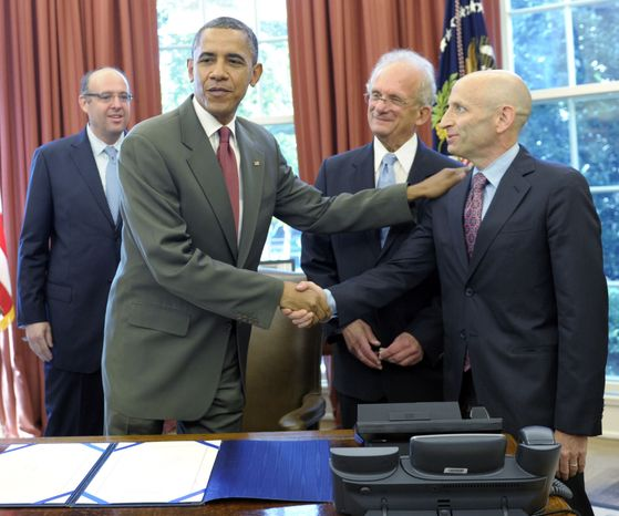 President Obama shakes hands July 27, 2012, with AIPAC chairman Lee Rosenberg in the Oval Office of the White House after signing the U.S.-Israel Enhanced Security Cooperation Act. Also present are Howard Friedman (left), former AIPAC chairman, and Rep. Howard Berman (second from right), California Democrat. (Associated Press)