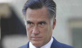 Republican presidential candidate and former Massachusetts Gov. Mitt Romney listens to a reporter's question at 10 Downing Street in London, Thursday, July 26, 2012. (AP Photo/Charles Dharapak)